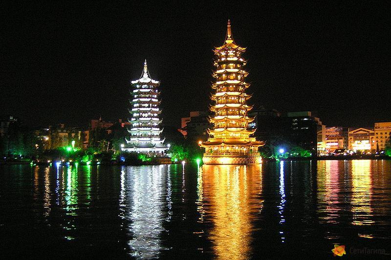 Lake Shanhu pagodas at night.